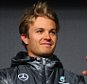 STUTTGART, GERMANY - NOVEMBER 29:  Mercedes GP Formula One drivers Nico Rosberg (L) of Germany and Lewis Hamilton of Great Britain on the stage during the annual Mercedes Benz Stars  Cars event in front of the Mercedes Benz Museum on November 29, 2014 in Stuttgart, Germany.  (Photo by Alex Grimm/Bongarts/Getty Images)