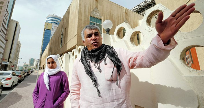Human rights activist Nabeel Rajab (R) gestures as he walks with his daughter Malak Rajab to attend his appeal hearing at court in Manama, February 11, 2015